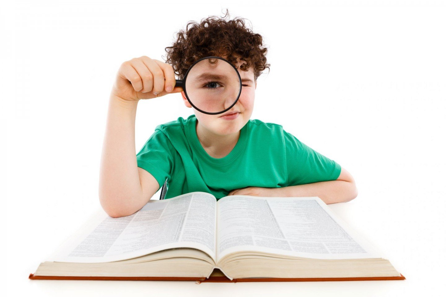 boy reading with magnifying glass