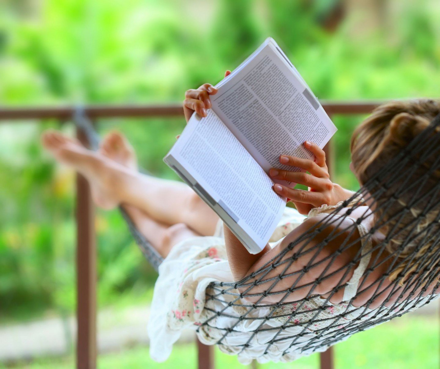 woman reading in hammock