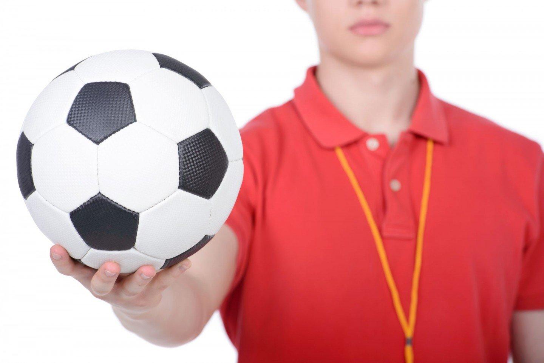 teacher holding soccer ball